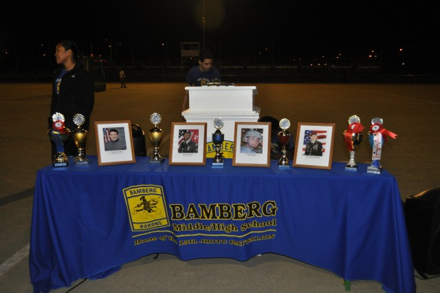 At U.S. Army Garrison Bamberg's 15th JROTC Battalion's memorial run May 10, the battalion had set up a table with pictures of the four Soldiers the run was commemorating.