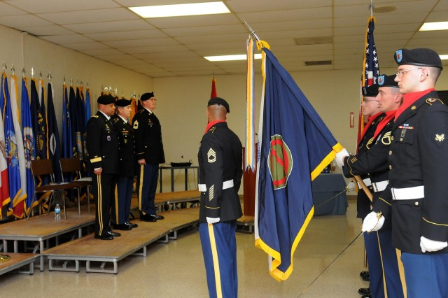Soldiers assigned to the 85th Support Command celebrate the U.S. Army's 238th birthday during their battle assembly, including (from left on platform) Brig. Gen. Gracus K. Dunn, commanding general, 85th Support command, and deputy-commanding general for support, First Army Division West, Command Sgt. Maj. Kevin J. Greene, 85th Support Command, and Master Sgt. Michael Kreinbring, 85th Support Command, stand as the color guard posts the colors to begin the ceremony at Arlinton Heights, Ill., June 1, 2013.
