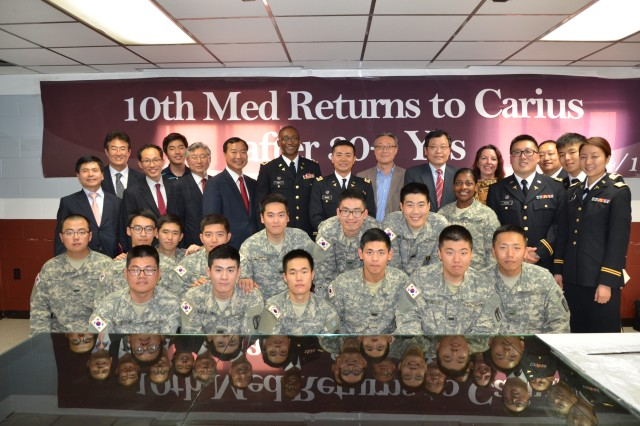 Former KATUSAs from the 10th MED poses with current KATUSAs and staff of the 618th Dental Company to mark their return after 30 years.
