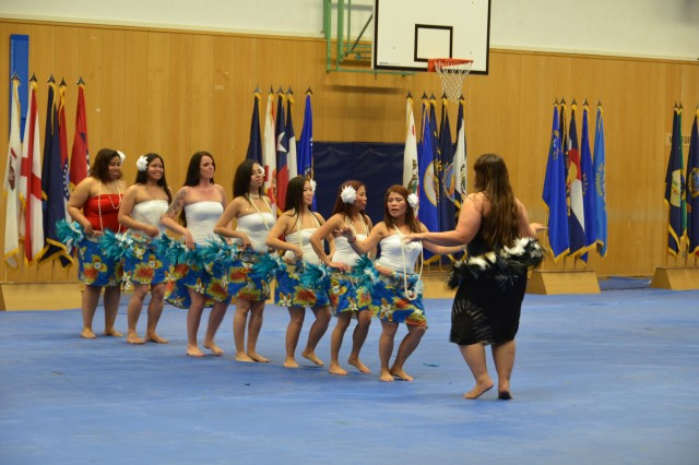 Members of Pacific Blend, a group out of U.S. Army Garrison Hohenfels that celebrates Asian-American and Pacific Islander culture, perform a dance at 412th Aviation Support Battalion and U.S. Army Garrison Ansbach's Asian-American and Pacific Islander Heritage Month observance May 31.