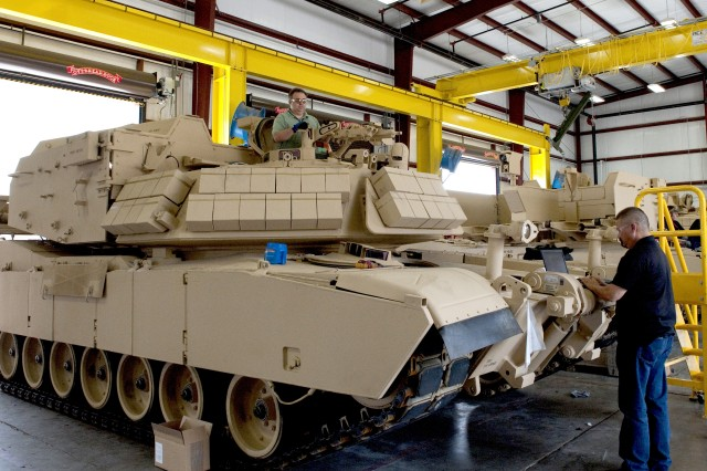 Todd Kohler, left, an Assault Breacher Vehicle quality assurance specialist; and Dane Kruse, a member of the new equipment training team for the ABV test and inspect a vehicle at Anniston Army Depot as it is prepared for fielding to a National Guard unit.