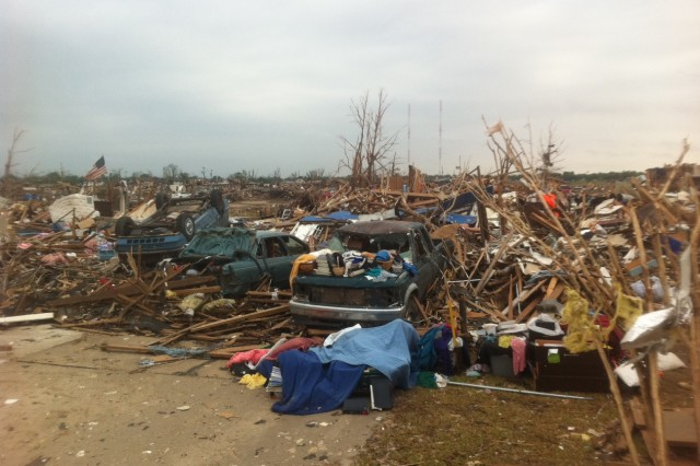 Homes were reduced to debris after a tornado hit Moore, Okla., on May 20. More than 20 people died.