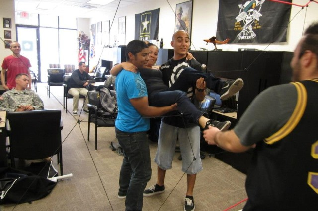 Future Soldiers from Yuma Recruiting Center, Ariz., use the new team building kits to develop problem solving skills and esprit de corps.