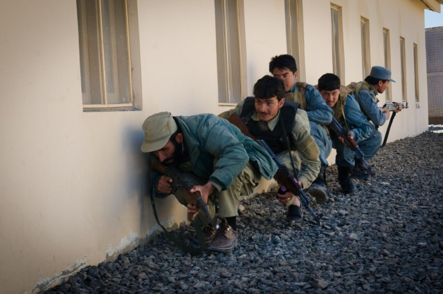 A squad of Afghan Uniform Police and Afghan Local Police trainees crouches beneath a window during urban operations training in Ghazni province, Afghanistan, April 11, 2013. The training was provided by U.S. Soldiers assigned to Security Force Assistance Team 6, Cross Functional Team Warrior, 10th Mountain Division.  (U.S. Army photo by Sgt. 1st Class Kenneth Foss/Released)