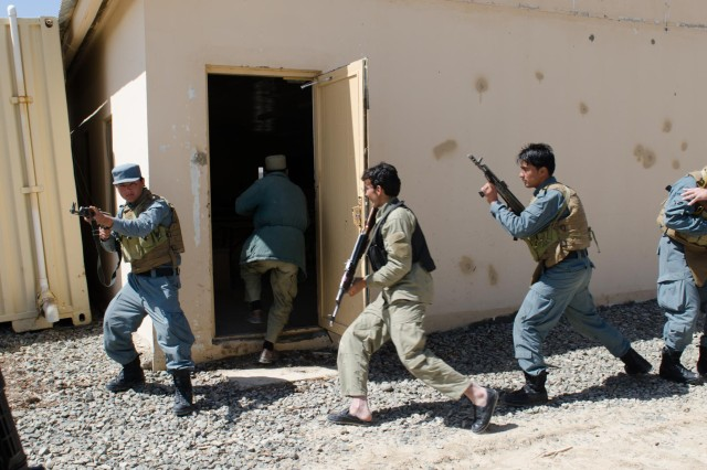 Afghan Uniform Police officers and members of the Afghan Local Police from the Aban district, enter a simulated suspected insurgent compound during a tactical urban maneuvers training mission in Ghazni province, Afghanistan, April 11, 2013. Their training was provided by members with Security Force Assistance Team 6, Cross Functional Team Warrior, 10th Mountain Division. (U.S. Army photo by Sgt. 1st Class Kenneth Foss/Released)