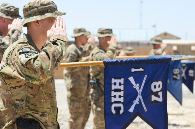 Cross Functional Team Summit, 1st Battalion, 87th Infantry Regiment, 10th Mountain Division add the Safety Excellence Streamer to their battalion colors during a ceremony held at Forward Operating Base Arian May 20, 2013. The Safety Excellence Streamer is awarded to units that have minimal safety violations during a required amount of training exercises. It is a rare occurrence for an infantry battalion to recieve this award. (Photo taken by U.S. Army Sgt. 1st Class Kenneth Foss)