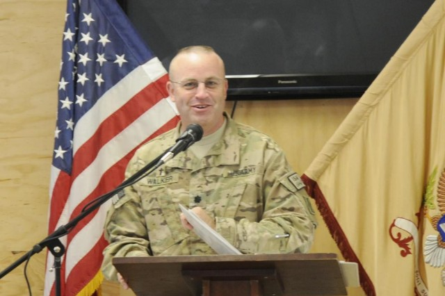 Chaplain (Lt. Col.) Gregory Walker, 3rd Infantry Division and Regional Command-South division chaplain, speaks during the dedication ceremony for Chaplain (Capt.) Dale Goetz, Forward Operating Base Walton, Kandahar Province, Afghanistan, May 30.  The dining facility at Walton was dedicated to Goetz, who was killed in Afghanistan in 2010.