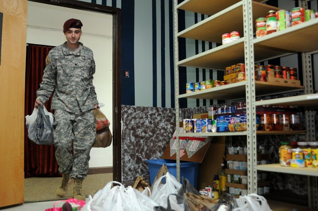 Spc. John Dodson helps stock the Paratrooper Assistance Pantry with food and childcare supplies, April 25. Organized by the Division chaplains, the pantry is a support system for Paratroopers who have fell on hard times and need food to sustain themselves and their families. Every soldier or family member who reaches out to the pantry will receive two days' worth of meals. Dodson, an aircraft structure repairer assigned to D Company, 3rd General Support Aviation Battalion, 82nd Airborne Division, and his fellow D Company paratroopers donated more than 500 cans of food to the pantry.