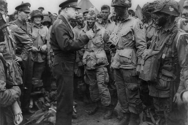 """General Dwight D. Eisenhower gives the order of the day """" """"Full victory; nothing else"""" """" to paratroopers just before they board their airplanes on the evening of June 5, 1944, as they prepared for the Battle of Normandy. The men are part of Company E, 502nd Parachute Infantry Regiment, at the 101st Airborne Division's camp in Greenham Common, England. Today marks the 69th anniversary of the epic battle that would seal the Division's fate as America's premiere fighting force."""