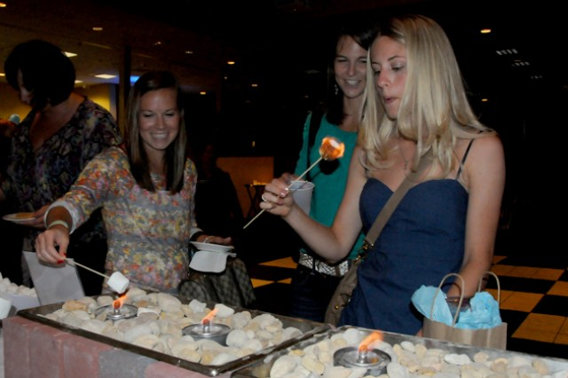 Paige Page, Wanetta Armitage and Kelsie Betts make s'mores at the DFMWR Pamper Yourself event at The Landing May 31.