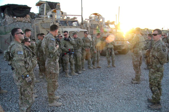 Soldiers with 2nd Platoon, Fox Company, 2nd Battalion, 506th Infantry Regiment, 4th Brigade Combat Team, 101st Airborne Division, receive a briefing before going on a mission in Khowst Province, Afghanistan, on May 30, 2013. (U.S. Army photo by Sgt. Justin A. Moeller, 4th Brigade Combat Team Public Affairs)
