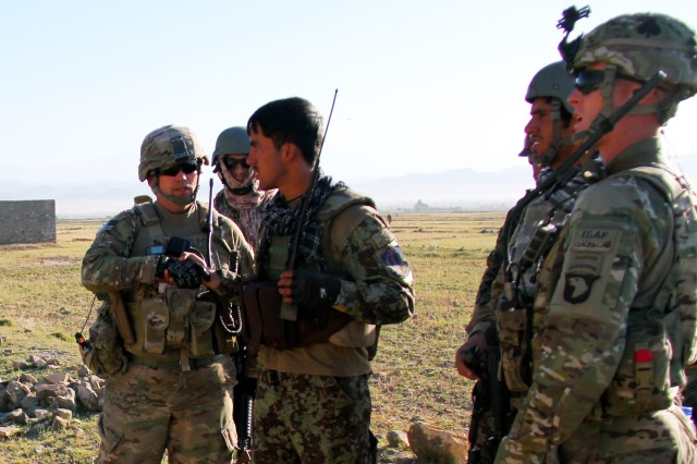 Members with the Security Force Advise and Assist Team 12 along with 2nd Platoon, Fox Company, 2nd Battalion, 506th Infantry Regiment, 4th Brigade Combat Team, 101st Airborne Division,  and the Afghan National Army 's 3rd Koy, 3rd Kandak, 1st Brigade, 203rd Corps talk during a mission in Khowst Province, Afghanistan, on May 30, 2013. (U.S. Army photo by Sgt. Justin A. Moeller, 4th Brigade Combat Team Public Affairs)