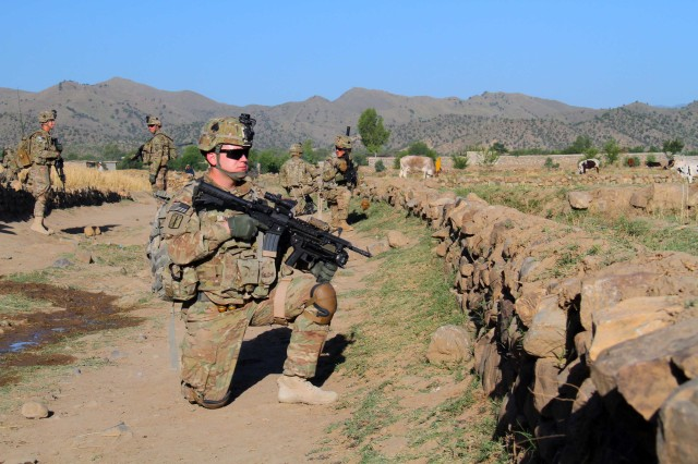 Soldiers with 2nd Platoon, Fox Company, 2nd Battalion, 506th Infantry Regiment, 4th Brigade Combat Team, 101st Airborne Division, pull security during a mission in Khowst Province, Afghanistan, on May 30, 2013. (U.S. Army photo by Sgt. Justin A. Moeller, 4th Brigade Combat Team Public Affairs)