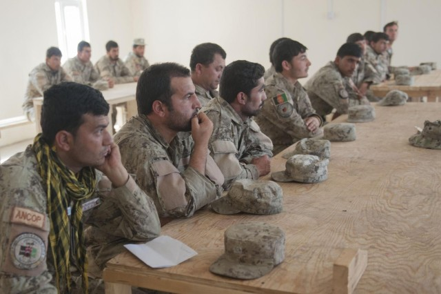 Afghan National Civil Order Police officers listen during classroom instructions on how to counteract improvised explosive devices during a two-week course by the Logar Afghan Uniformed Police Security Force Advise and Assist Team at Patrol Base Pul-e-Alam in Logar province, Afghanistan, May 23, 2013. The training also covered tactical skills such as clearing rooms and mission planning to enable Afghan forces to better secure their country. The Logar Afghan Uniformed Police Security Force Advise and Assist Team is assigned to the 4th Infantry Brigade Combat Team, 3rd Infantry Division. (U.S. Army National Guard photo by Sgt. Julieanne Morse/Released)