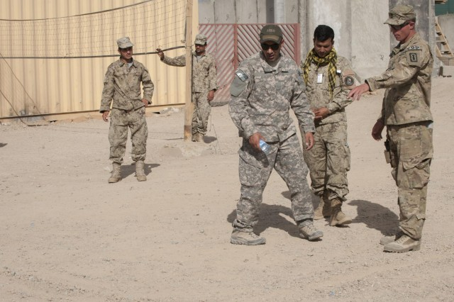 U.S. Army Sgt. 1st Class Ryan Jaminet, right, an explosive ordnance disposal specialist with the 731st Explosive Ordnance Disposal Company, teaches techniques for finding improvised explosive devises (IEDs) to Afghan National Civil Order Police officers at Patrol Base Pul-e-Alam in Logar province, Afghanistan, May 23, 2013. The Logar Afghan Uniformed Police Security Forces Advise and Assist Team with the 4th Infantry Brigade Combat Team, 3rd Infantry Division, provided training on finding IEDs in order to minimize the effect of IEDs on Afghan and coalition Forces. (U.S. Army National Guard photo by Sgt. Julieanne Morse/Released