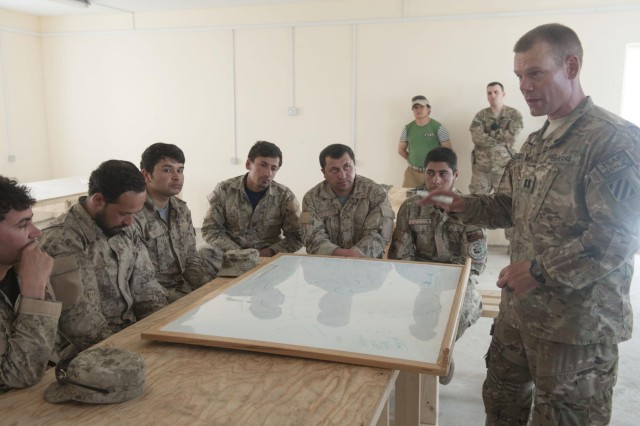 Capt. Jason Imboden, a member of the Logar Afghan Uniformed Police Security Force Advise and Assist Team with 4th Infantry Brigade Combat Team, 3rd Infantry Division, teaches members of the Afghan National Civil Order Police tactics to finding and reacting to improvised explosive devices at Patrol Base Pul-e-Alam, May 23, 2013. The two-week tactical training course will improve Afghan forces ability to provide security for their country. (U.S. Army National Guard photo by Sgt. Julieanne Morse, 129th Mobile Public Affairs Detachment/RELEASED)