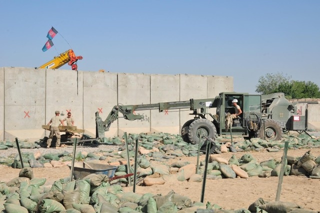 Soldiers of Company B, 4th Battalion, 9th Infantry Regiment, Combined Task Force 4-2 (4th Stryker Brigade Combat Team, 2nd Infantry Division), load scrap wood onto a forklift, May 12, 2013, on Combat Outpost Talukan in the Panjwa'i district of Afghanistan. After living on the COP for nearly eight months, the Soldiers of B Company demilitarized the COP including tearing down their sleeping tents.