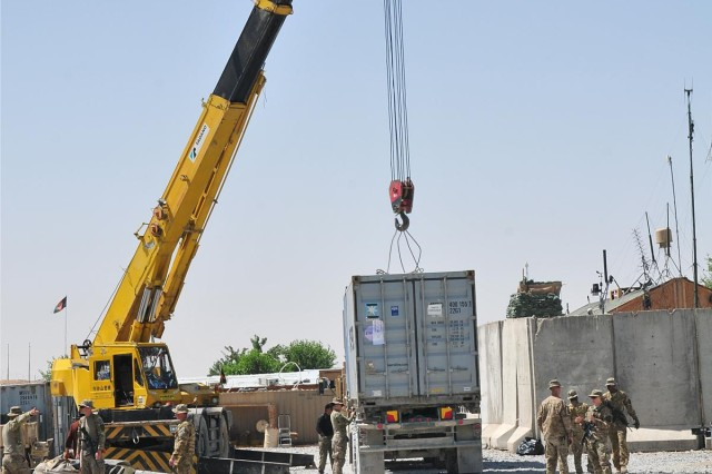 Soldiers of 702nd Brigade Support Battalion and Company B, 4th Battalion, 9th Infantry Regiment, load a container onto a flatbed truck, May 12, 2013, on Combat Outpost Talukan in the Panjwa'i district of Afghanistan. The battalions, both assigned to Combined Task Force 4-2 (4th Stryker Brigade Combat Team, 2nd Infantry Division), helped demilitarize COP Talukan.