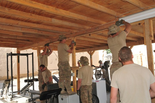 Soldiers of Company B, 4th Battalion, 9th Infantry Regiment, Combined Task Force 4-2 (4th Stryker Brigade Combat Team, 2nd Infantry Division), pull down wires in the gym, May 22, 2013, on Combat Outpost Talukan in the Panjwa'i district of Afghanistan.