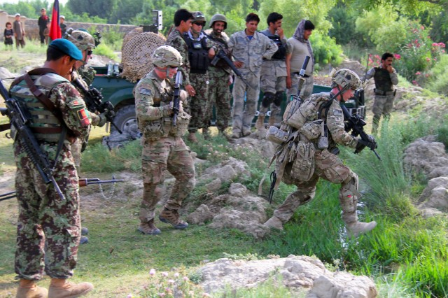 "KHOWST PROVINCE, Afghanistan "" Sgt. Joseph L. Hull, an infantryman with 2nd Platoon, Easy Company, 2nd Battalion, 506th Infantry Regiment, 4th Brigade Combat Team, 101st Airborne Division, takes is turn to jump across a stream while on patrol in a village in Khowst Province, Afghanistan, on June 2, 2013. (Photo by Sgt. Justin A. Moeller, 4th Brigade Combat Team Public Affairs)"