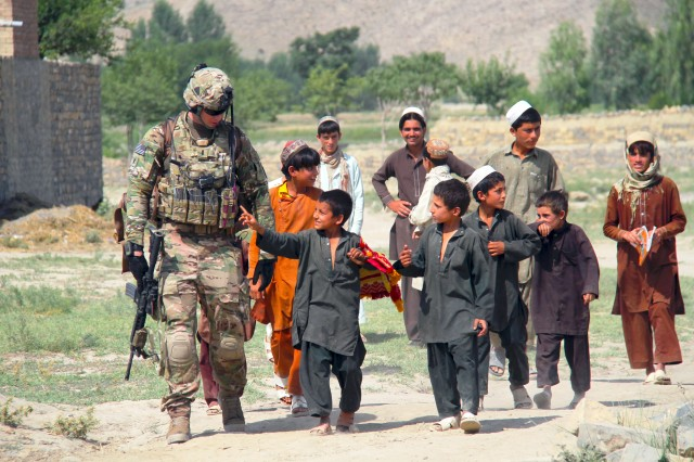 "KHOWST PROVINCE, Afghanistan "" While on patrol, 1st Lt. Brendan D. Murphy of Easy Company, 2nd Battalion, 506th Infantry Regiment, 4th Brigade Combat Team, 101st Airborne Division, talks with the children of a village in Khowst Province, Afghanistan, on June 2, 2013. (Photo by Sgt. Justin A. Moeller, 4th Brigade Combat Team Public Affairs)"