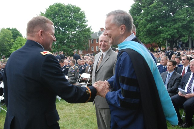 A graduate takes time to thank members of the faculty team for his War College year. The school takes great pride in its high quality faculty and staff.