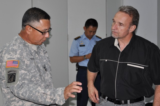 SENTUL, Indonesia - Maj. Gen. Gary Hara, Deputy Commander for the Army National Guard, U.S. Army Pacific (USARPAC) discusses the progress being made during Gema Bhakti with Pete DeFelice, a multi-national exercise planner assigned to U.S. Army Pacific, Camp Smith, Hawaii, June 7.  Gema Bhakti is a combined Humanitarian Assistance Disaster Relief Staff Exercise which brings together several military forces from U.S. Army Pacific Command, U.S. Navy and Air Force to work side-by-side personnel from the Tentara Nasional Indonesia military to create response planning to assist Indonesia in responding more efficiently should they experience a natural disaster.