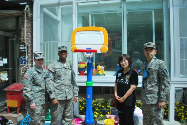 Three representatives of the 251st Signal Detachment including Capt. Tremain L. Fergerson, Commander of the 251st visited Namsanwon Community Orphanage in Seoul, 30 May to donate toys and clothes. Discussions on current needs of the orphanage and how 251st could continue to support were carried out with Mrs. Duk Rye Ryu, resource manager of Namsanwon.