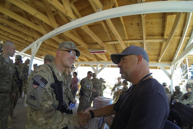 Self-made multimillionaire Steve Kaplan shares handshakes and stories, June 8, with soldiers deployed to Forward Operating Base Frontenac during Operation H.O.T. in Regional Command-South, Afghanistan. (U.S. Army photo by Sgt. Uriah Walker, RC(S) Public Affairs)