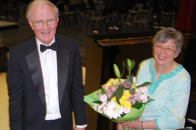 Vicenza Middle School music director Eldon Kirkhum and his wife Nancy pose with a bouquet they received from student musicians at the conclusion of the VMS Spring Concert May 15 in Vicenza, Italy.