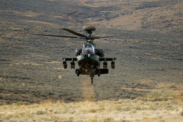 "A new study by Army researchers looks at inserting carbon nanotubes into the structural design of helicopter rotor blades to improve performance. Pictured here, an AH-64 Apache rises from behind a hill during a training exercise at Yakima Training Center, Wash. The AH-64E Guardian replaces the AH-64D ""Longbow"" and integrates more powerful engines, improved rotor blade technology and advanced electronics."