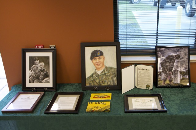 Various artifacts donated by the family of Spc. Daniel Lucas Elliott for the ceremony dedicating and renaming the Cary Army Reserve center in his honor. Elliott was killed in action in July 15, 2011 in Basra, Iraq, while deployed with the 805th Military Police Company.