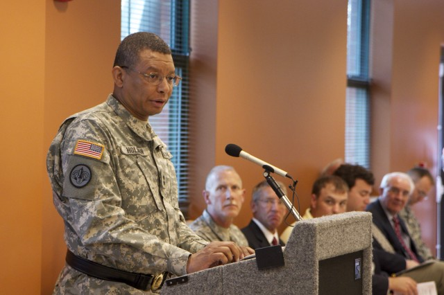 Maj. Gen. Sanford Holman, commander of the 200th Military Police Command, speaks during the ceremony to memorialize and renamed the Cary, N.C., Army Reserve center in honor Spc. Daniel Lucas Elliott June 8, 2013. Spc. Elliott was killed in action July 15, 2011 in Basra, Iraq, while deployed with the 805th Military Police Company.