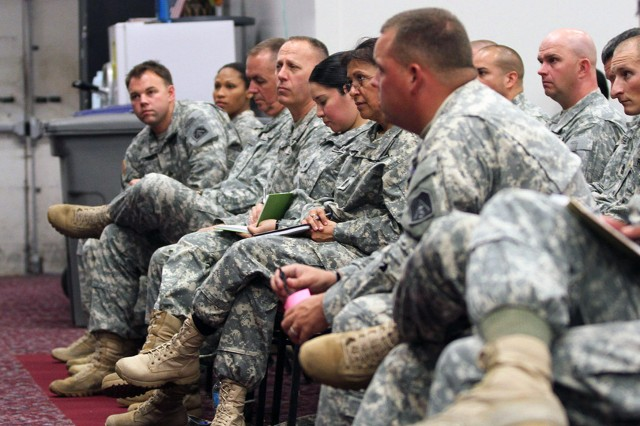 "FORT SAM HOUSTON, Texas "" Noncommissioned officers from U.S. Army North (Fifth Army) take notes as Command Sgt. Maj. Hu Rhodes provides his insights during the NCO professional development session May 30 in the Warfighter and Family Readiness Center. Rhodes, the senior enlisted leader for Army North, Fort Sam Houston and Camp Bullis, built the discussion around topics including suicide prevention, sexual assault and harassment prevention, and the expected effects of sequestration."