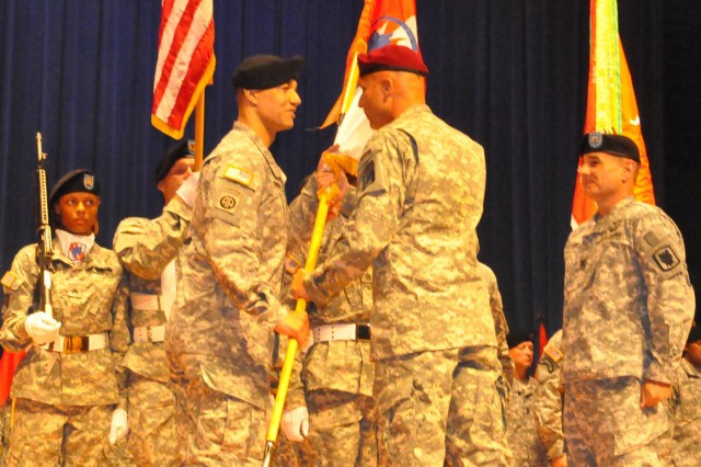 Col. Thomas A. Pugh, the outgoing commander of the 35th Signal Brigade, watches Lt. Gen. Joseph Anderson, the commander of XVIII Airborne Corps and Fort Bragg, N.C., pass the brigade colors to Col. Robert L. Edmonson II, symbolizing his responsibility of command, at the brigade change of command ceremony at Alexander Hall on Fort Gordon, Ga., June 7, 2013. The 35th Signal Brigade is one of the largest tactical communication units in the armed forces, and has provided support throughout the Middle East and Afghanistan in support of the global war on terrorism.