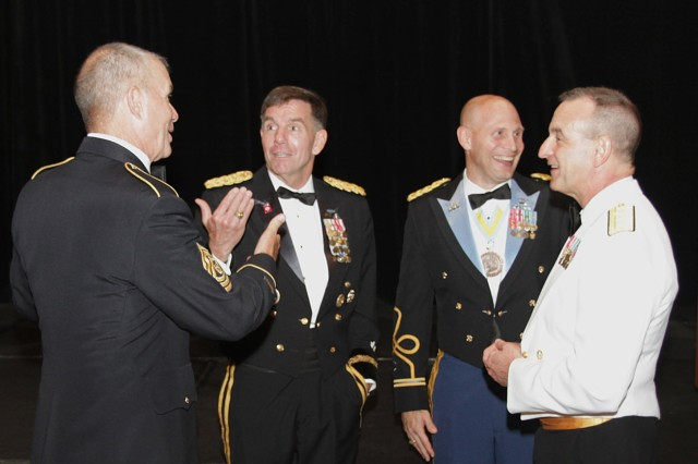 "SAN ANTONIO, Texas "" Command Sgt. Maj. Hu Rhodes (left) jokes with Lt. Gen. William Caldwell IV, Lt. Col. Jack Vantress and Navy Rear Admiral William Roberts prior to the kickoff of the 238th Army Birthday Ball June 1 at the Grand Hyatt in San Antonio. Caldwell is the commanding general of U.S. Army North (Fifth Army) and senior commander of Fort Sam Houston and Camp Bullis; Rhodes is his senior enlisted advisor. Vantress serves as Caldwell's executive officer and Roberts is the commandant for the Medical Education and Training Campus."
