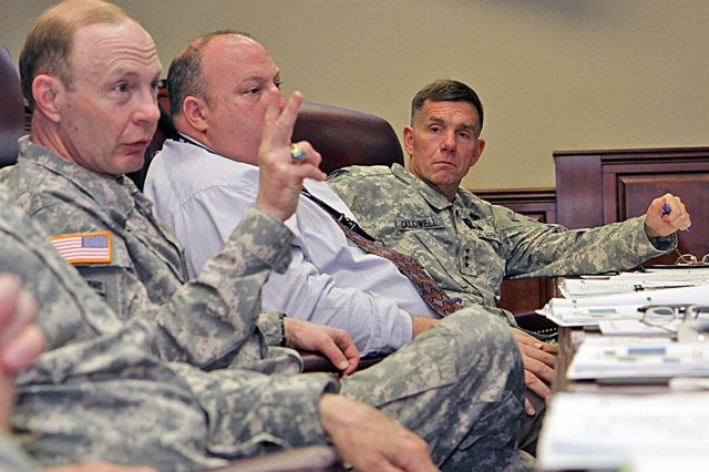 Gen. Charles Jacoby Jr. (left), commanding general, North American Aerospace Defense Command and U.S. Northern Command, illustrates the importance of preparedness for any eventuality, as Robert Fenton Jr. (center), assistant administrator, Response and Recovery, Federal Emergency Management Agency, and Lt. Gen. William Caldwell IV, commanding general, U.S. Army North (Fifth Army), and senior leader for Fort Sam Houston and Camp Bullis, look on during the Complex Catastrophe Tabletop Exercise, held June 5, 2013, at Army North in the historic Quadrangle at Fort Sam Houston, Texas.