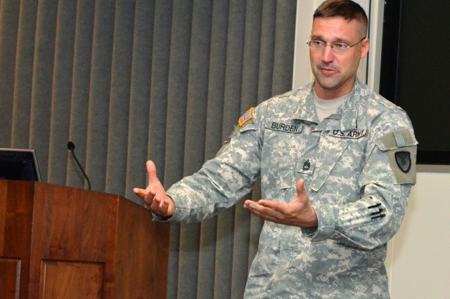 Sgt. 1st Class Larry Burden, Army Sustainment Command, Rock Island Arsenal, Ill., gives his testimonial on what he learned to lead more effectively by adjusting to people's personalities. (Photo by Liz Adolphi, ASC Public Affairs)