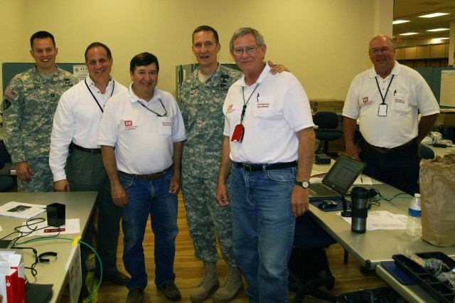 U.S. Army Corps of Engineers Southwestern Division Commander Brig. Gen. Thomas Kula, center, takes a moment to thank some of the Emergency Support Function No. 3 Team while at the Joint Field Office in Oklahoma City during a site visit, May 31. The USACE is supporting FEMA Region VI disaster response to the recent Oklahoma tornadoes. Pictured from left to right, Capt. David Freeman, Anthony Semento, Cecil Jernigan, Kula, Whit Barton and Terry Sharpless.