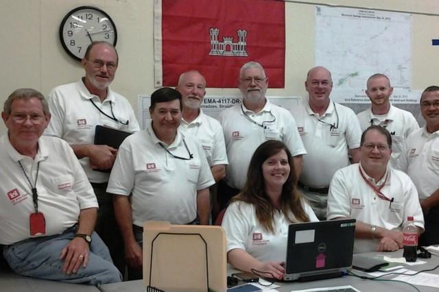 The U.S. Army Corps of Engineers ESF#3 Team Oklahoma Tornado 2013: Left to right back row:  Whit Barton (Debris SME), Bob Chitwood (Debris SME), Cecil Jernigan (Debris SME), Olen Burditt (Debris SME), Greg Williams (Debris SME), Terry Sharpless (Debris SME), Wes Trammell (Debris SME), Greg Deleon-Guerrero (TL) Kerri Stark (ATL), Peter Navesky (Permanent Cadre).