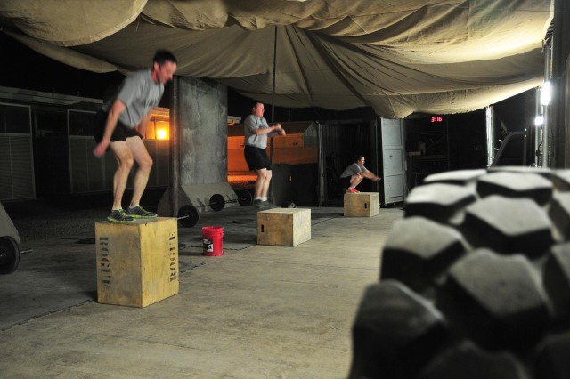 Soldiers with Combined Task Force 4-2 (4th Stryker Brigade Combat Team, 2nd Infantry Division) perform box jumps during a CrossFit workout June 4 on Kandahar Airfield, Afghanistan. (U.S. Army photo by Sgt. Kimberly Hackbarth, CTF 4-2 PAO)
