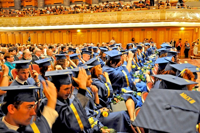 Wiesbaden High School's Class of 2013 move their tassels from side to side during the commencement ceremony in the Wiesbaden Kurhaus June 9.