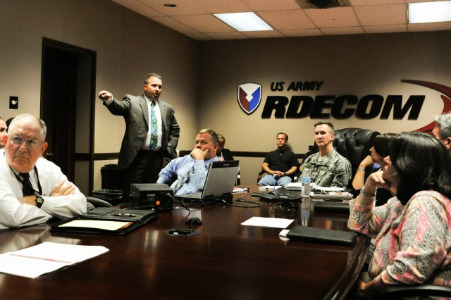 Cpl. Joe Pompilii of the Maryland State Police briefs the U.S. Army Research, Development and Engineering Command's protection committee June 6 on gang activity.