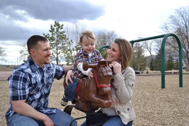 FORT CARSON, Colo. -- Noah Waterman rides a horse while his father Morgan Waterman, and his mother Rebecca Waterman, personnel officer, 759th Military Police Battalion, help to keep him in place, at Iron Horse Park, March 29, 2013. Morgan Waterman is a stay at home dad, who daily helps his son with a number of medical issues due to a premature birth and other conditions related to Rebecca Waterman having a low blood platelet count, a condition that affects 3% of the population. (Photo courtesy of Capt. Rebecca Waterman, 759th Military Police Battalion)