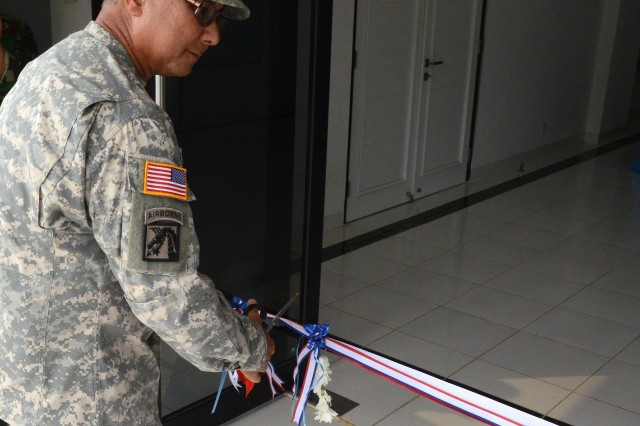 Maj. Gen. Gary Hara, Deputy Commander of the Hawaii Army National Guard, U.S. Army Pacific participates in a ribbon cutting ceremony at the new International Peace and Security Center barracks in Sentul, Indonesia, 7 June.  Funding for the construction of the barracks was made possible by the ongoing Global Peacekeeping Initiative, a U.S. Department of State program that assists in building partner country capabilities.
