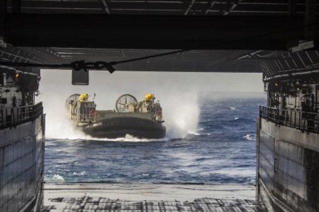 A U.S. Navy landing craft, air cushion, or LCAC, enters the well deck of amphibious transport dock ship USS San Antonio, in preparation for Exercise Eager Lion, June 6, 2013.