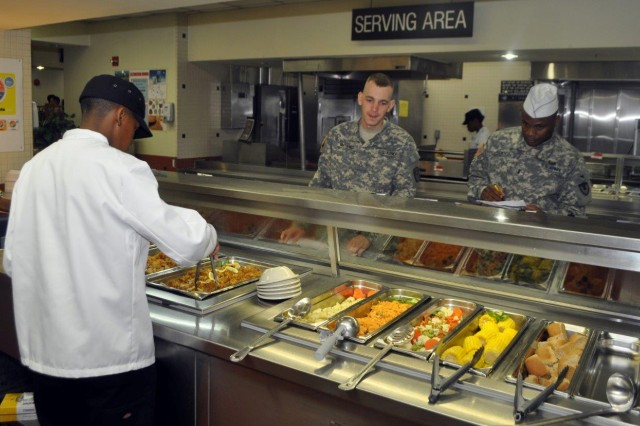 A judge evaluates how the Rotor Wash Café Dining Facility on K-16 operates during the Phillip A. Connelly Competition, June 11. (U.S. Army photo by Cpl. Lim Hong-seo)