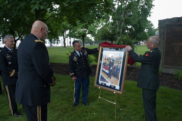 U.S. Army Col. Stephen J. Maranian, left,  class president, and Indian Fellow Brigadier Shashank Upasani, right, international fellows Vice President, present a painting depicting the Gettysburg Address by U.S. President Abraham Lincoln to Army Chief of Staff Gen. Ray Odierno at the Army War College in Carlisle Barracks, Pa. June 8, 2013. The painting was a token of appreciation for Odierno, who was the guest speaker for the graduation ceremony of Class of 2013. (U.S. Army photo by Staff Sgt. Teddy Wade/ Released)