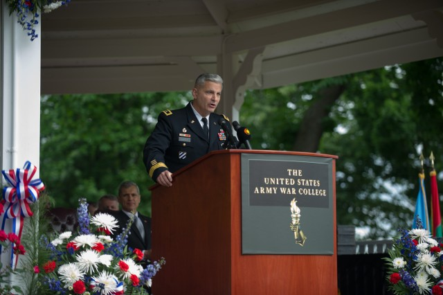 Commandant of the Army War College Maj. Gen. Tony Cucolo introduces Army Chief of Staff Gen. Ray Odierno as the keynote speaker for class of 2013 graduation ceremony in Carlisle Barracks, Pa. June 8, 2013. (U.S. Army photo by Staff Sgt. Teddy Wade/ Released)