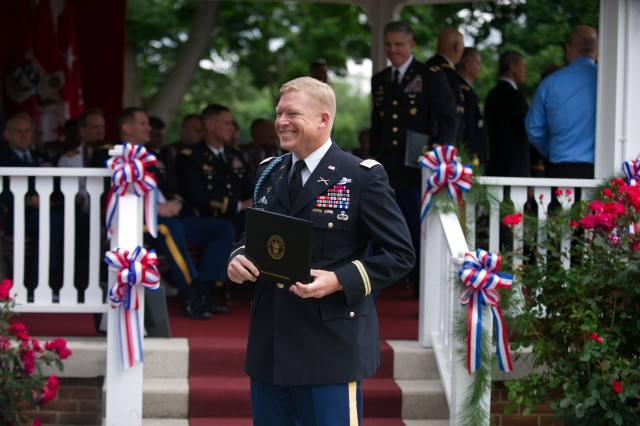 U.S. Army Col. Mark O'Donnell smiles after receiving his diploma from the Army War College at the class of 2013 graduation ceremony in Carlisle Barracks, Pa. June 8, 2013. (U.S. Army photo by Staff Sgt. Teddy Wade/ Released)